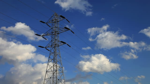 MS T/L Shot of electric pylons and clouds moving in sky / Fujinomiya, Shizuoka, Japan