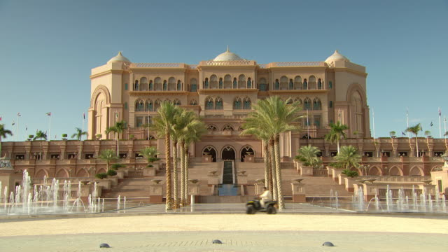 MS Shot of Emirates Palace with vehicle passing / Abu Dhabi, United Arab Emirates