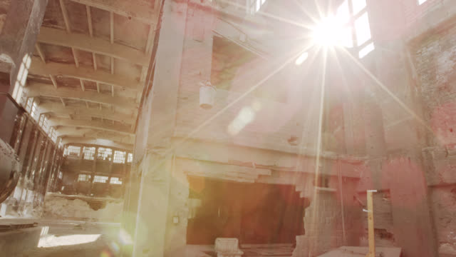 """ws pan slo mo shot of empty abandoned factory with sun flooding through windows / berlin, germany"" - bad condition stock videos and b-roll footage"
