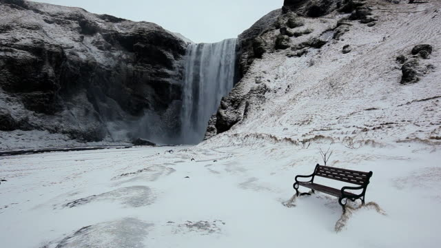 ms shot of empty bench next to waterfall / iceland  - waterfall stock videos & royalty-free footage