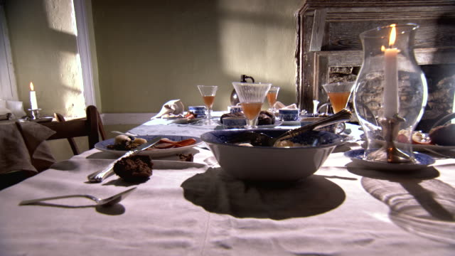 MS TU Shot of empty dinner table abandon as if people had run away during meal / Middleburg, Virginia, United States