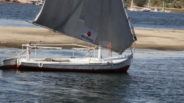 MS Shot of Empty felucca moving with operator / Aswan, Egypt