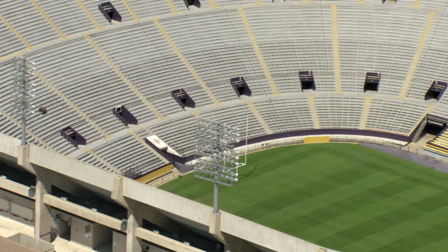 ms aerial shot of empty louisiana state university tiger stadium and bleachers / baton rouge, louisiana, united states - baton rouge stock-videos und b-roll-filmmaterial