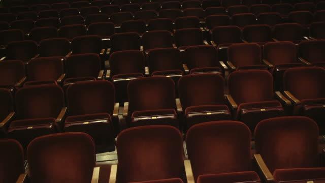vídeos y material grabado en eventos de stock de ms shot of empty seats in concert hall / ann arbor, michigan, united states - ann arbor