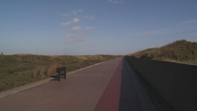 WS Shot of empty sidewalk / Knokke Heist, Flanders, Belgium