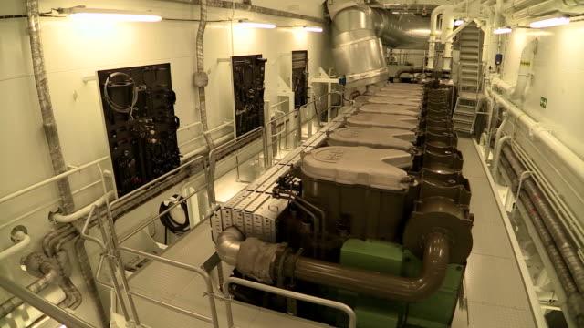 stockvideo's en b-roll-footage met ms pan shot of engine room of container vessel / baltic sea, poland - machinekamer