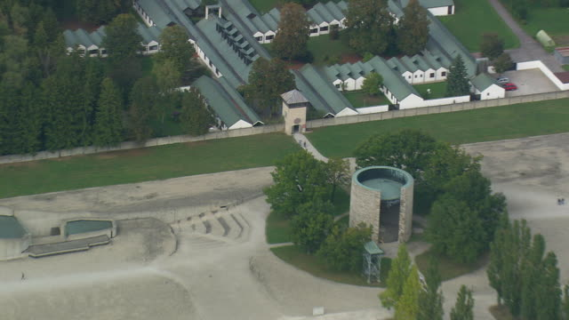 ms aerial zo shot of entrance get of dachau concentration camp / germany - konzentrationslager stock-videos und b-roll-filmmaterial