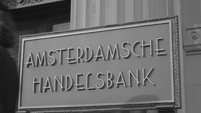 ms zi shot of entrance of bank in netherlands on bank sign - entrance sign stock videos & royalty-free footage
