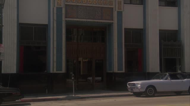 MS Shot of entrance to large older office building