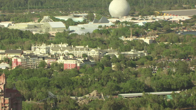 ms aerial td shot of epcot center and pink hollywood tower / orlando, florida, united states - epcot stock videos and b-roll footage