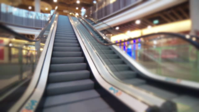 ls shot of escalator upstairs. - shopping centre stock videos & royalty-free footage