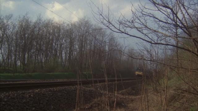 ms shot of european passenger railroad train run by - anno 1981 video stock e b–roll