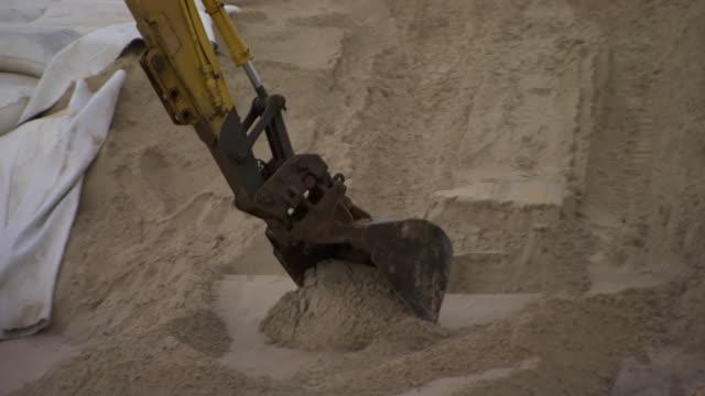 cu zo shot of excavator digging near sandbag with house / kingscliff, new south wales, australia - digging点の映像素材/bロール