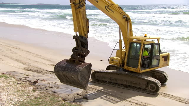 MS PAN HA Shot of Excavator digging on beach / Kingscliff, New South Wales, Australia