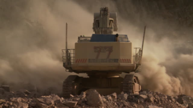 CU PAN Shot of excavator working on construction site / Namibia