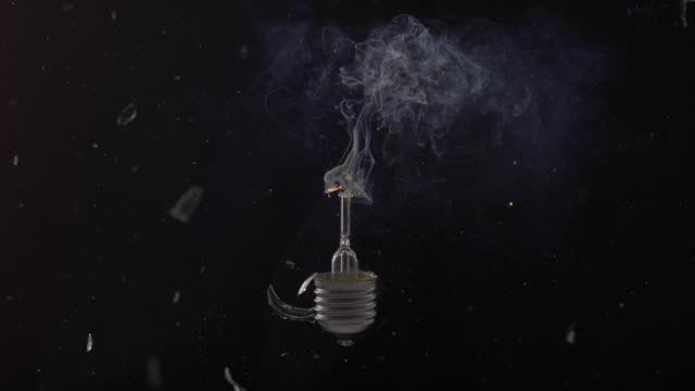 cu slo mo shot of exploding light bulb / munich, bavaria, germany - glühbirne stock-videos und b-roll-filmmaterial