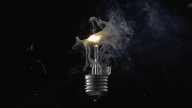 vídeos de stock e filmes b-roll de cu slo mo shot of exploding light bulb with smoke coming out / munich, bavaria, germany - light bulb