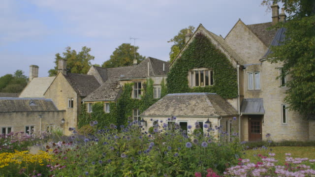 ws shot of ext large country house  / upper  slaughter, gloucestershire, united kingdom   - gloucestershire stock videos and b-roll footage