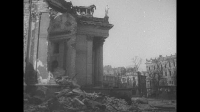 shot of exterior of damaged church / wrecked buildings and rubble in street / statue of lion damaged building in background / three shots of wrecked... - warsaw stock videos & royalty-free footage