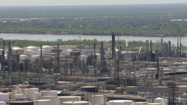 ms aerial shot of exxon mobil factory with mississippi river / louisiana, united states - exxon stock videos & royalty-free footage