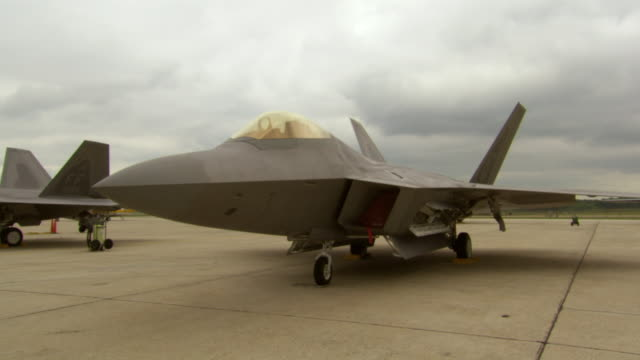 ms shot of f22 raptor parked at andrews air force base / prince george's county, maryland, united states - stationary stock videos & royalty-free footage