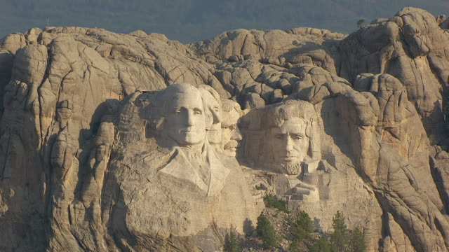 MS AERIAL TS ZO Shot of face of George Washington at Mount Rushmore and pull out to reveal faces of Thomas Jefferson and Theodore Roosevelt and Abraham Lincoln / South Dakota, United States