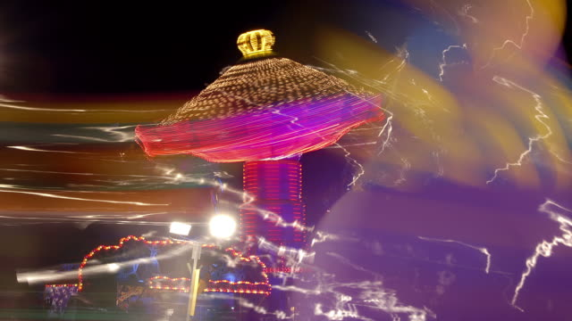ms t/l shot of fairground rides fast carousel in back side with slow carousel at night time in winter wonderland hyde park / london, greater london, united kingdom - greater london stock videos & royalty-free footage