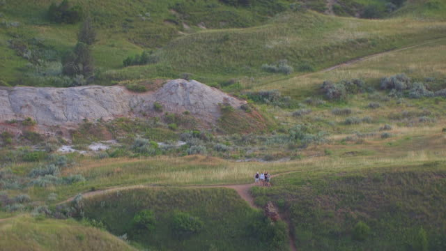MS AERIAL TS ZO Shot of Family of hikers at Theodore Roosevelt National Park / North Dakota, United States