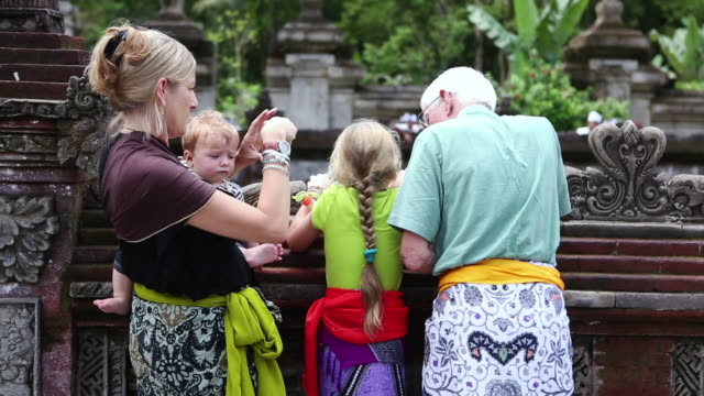MS Shot of family touring in city / Ubud, Bali, Indonesia