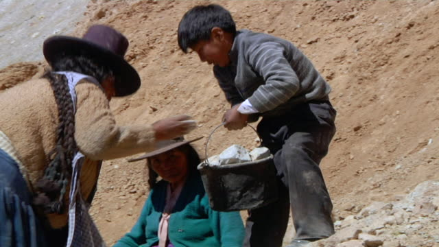 stockvideo's en b-roll-footage met shot of family working in mining / potosi bolivia - bolivia