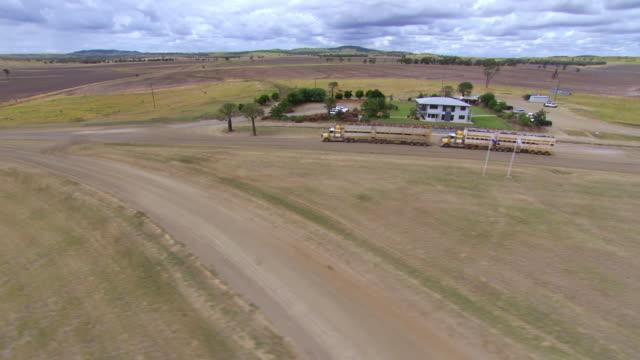 WS AERIAL Shot of farm house at feedlot / Roma, Queensland, Australia