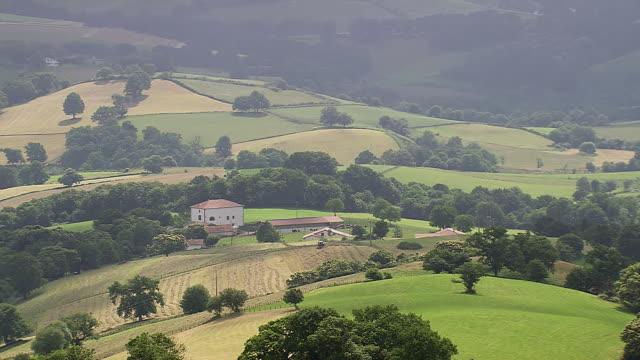 WS AERIAL Shot of farm houses at Pyrenees / Midi Pyrenees, France