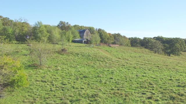 MS AERIAL TU Shot of farmland to reveal countryside / Missouri, United States