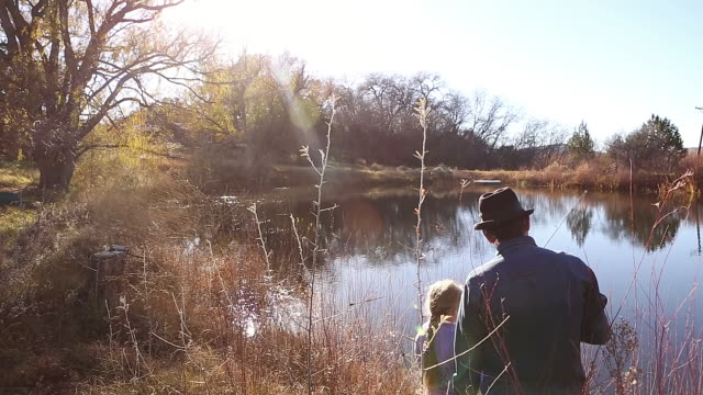 ms td shot of father and daughter fishing in pond / lamy, new mexico, united states - pond stock videos & royalty-free footage