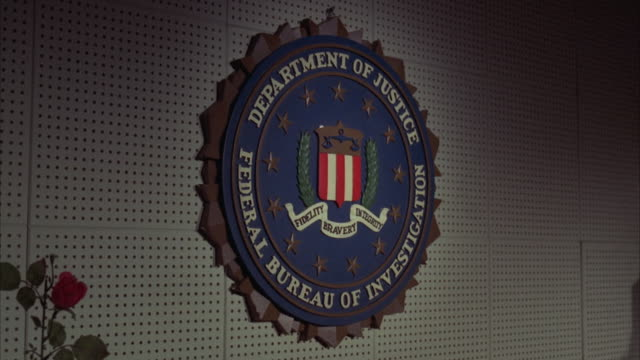 ms shot of fbi seal on wall - fbi stock videos & royalty-free footage