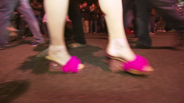 CU TS Shot of feet in sparkly pink heels walking during high heel race in DuPont Circle / Washington, Dist. of Columbia, United States