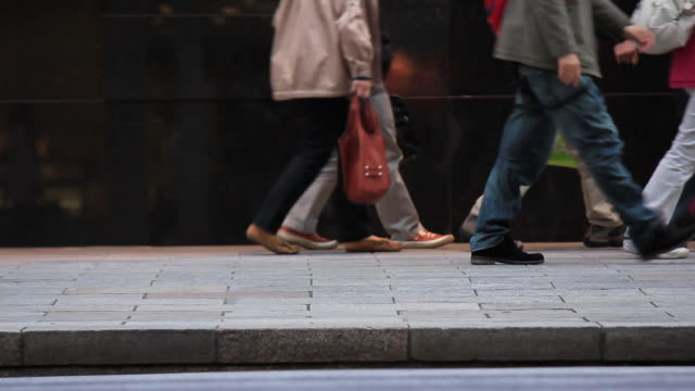 ms shot of feet of crowd / ginza, tokyo, japan - pavement stock videos & royalty-free footage