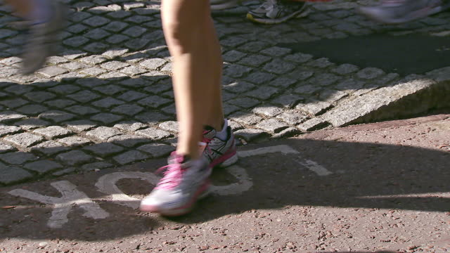 ms shot of feet of runners arriving to take part in london marathon / london, united kingdom  - london marathon stock videos & royalty-free footage