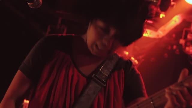 cu tu td shot of female bass guitarist singing and head banging / shimokitazawa, tokyo, japan - head banging stock videos & royalty-free footage