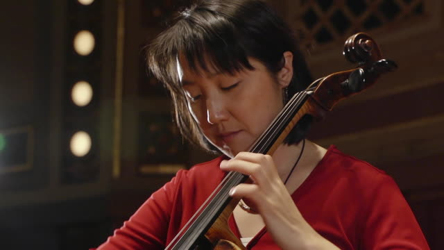 MS TU TD Shot of female cellist practicing solo piece on stage AUDIO / Ann Arbor, Michigan, United States