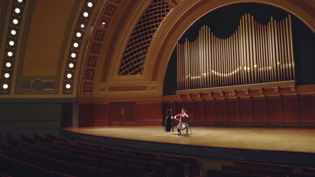 ws tu shot of female cellist practicing solo piece on stage in empty concert hall audio / ann arbor, michigan, united states - plucking an instrument stock videos & royalty-free footage