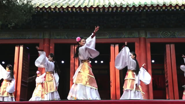WS SLO MO Shot of female dancers performing in traditional costume AUDIO / Beijing, Hebei Province, China