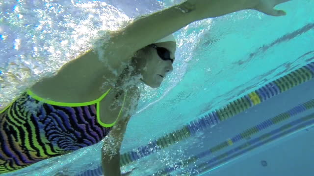 cu pov ts slo mo shot of female freestyle swimmer in lane / davis, california, united states  - swimming goggles stock videos & royalty-free footage