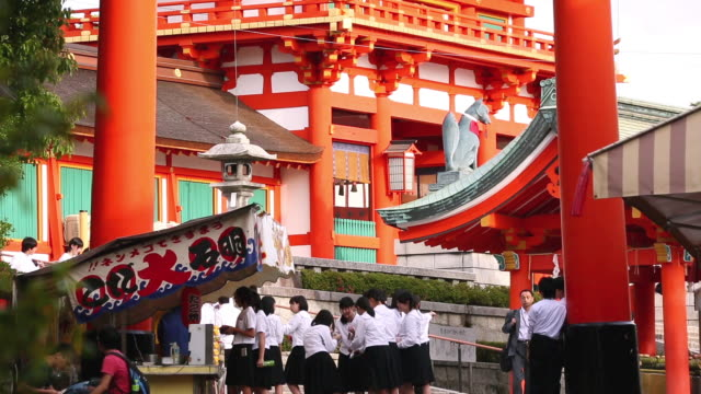 MS Shot of female high school students who are visiting Fushimi Inari Taisha by school trip / Fushimi ku, Kyoto, Japan.