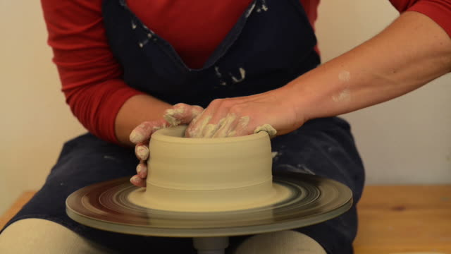ms shot of female potter shapes pitcher from lump of clay on potterwheel at pottery / landshut, bavaria, germany - pitcher jug stock videos & royalty-free footage
