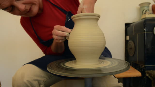 ms tu shot of female potter shapes pitcher from lump of clay on potterwheel at pottery / landshut, bavaria, germany - pitcher jug stock videos & royalty-free footage