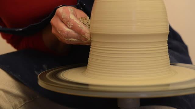 cu tu shot of female potter shapes pitcher on potterwheel at pottery / landshut, bavaria, germany - pitcher jug stock videos & royalty-free footage