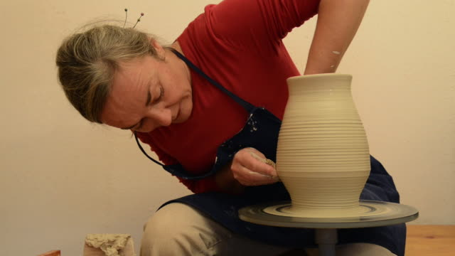 ms tu shot of female potter shapes pitcher on potterwheel at pottery / landshut, bavaria, germany - pitcher jug stock videos & royalty-free footage