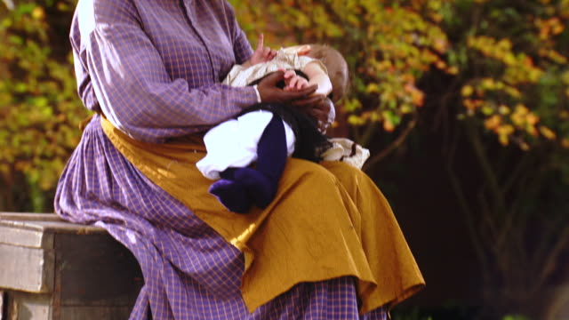 MS TU Shot of female slave holds white baby on her lap / Culpeper, Virginia, United States