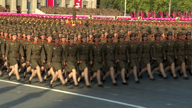 Shot of female soldiers marching in formation during a military parade at Kim Ilsung Square Pyongyang